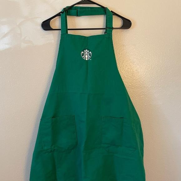 Two green Starbucks Aprons